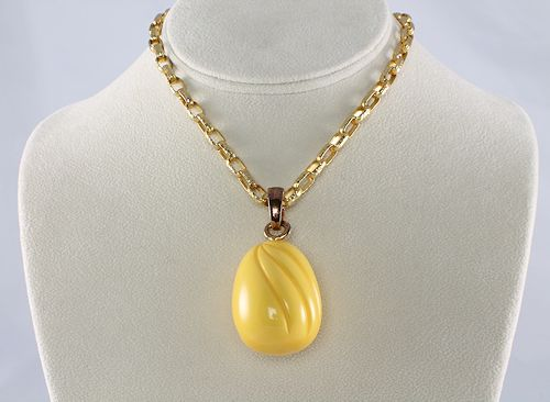 Yellow carved Bakelite necklace egg pendant